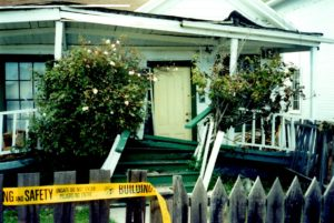 Earthquake damaged house in Santa Cruz after the Loma Prieta quake in 1989 (San Andreas fault) - earthquake insurance would help to pay for rebuilding here